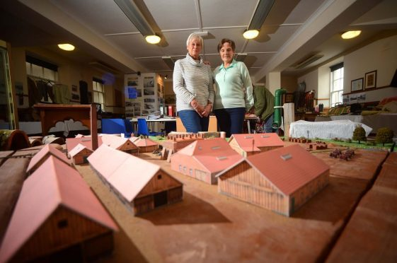Volunteers Heather Hill and Mary Duncan with the model of the old brick factory in Cullen.