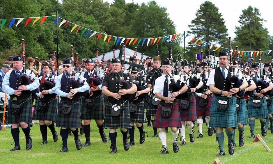 The massed pipe bands perform.    Picture by Kami Thomson