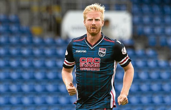 Thomas Mikkelsen has struggled for game time at Ross County.