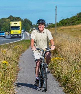 Council leader George Alexander cycled from Forres to the meeting to show his support for the plans