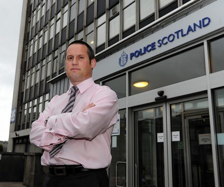 Pictured is Detective Inspector Iain McPhail at Aberdeen Queen Street Police Station. Pictured by Darrell Benns 23/10/2014