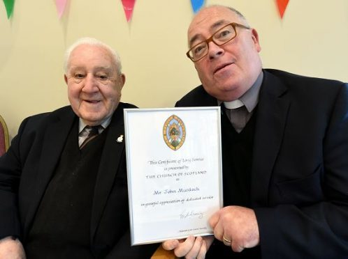 Birthday boy John Murdoch (L) and the Rev Alec Wark who presented him with a long service award