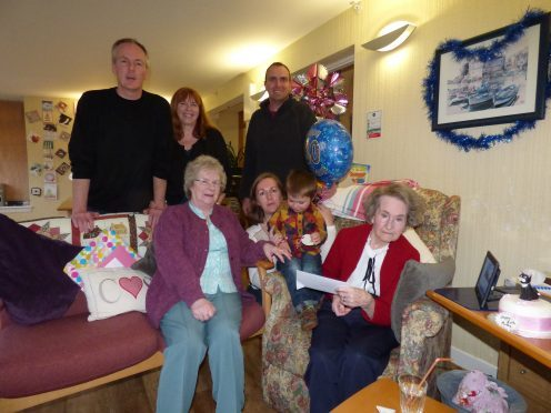 Mollie McNeill with her family at her 80th birthday party in the Dail Mhor care home in Strontian last year.