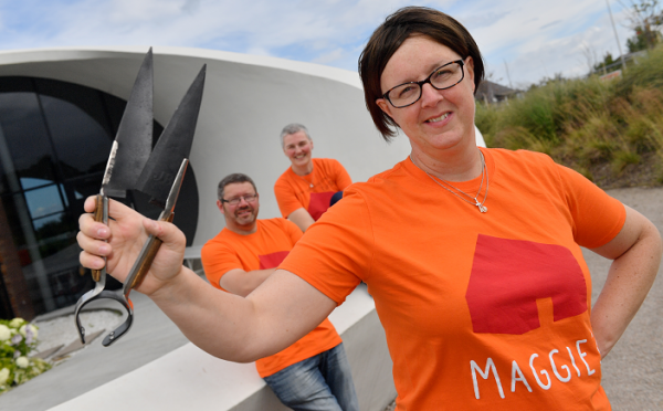 Angela Findlay shears in hand (front) with her husband Scott Findlay who was waxed and Fiona Walker who had her head shaved to raise funds for Maggie's.