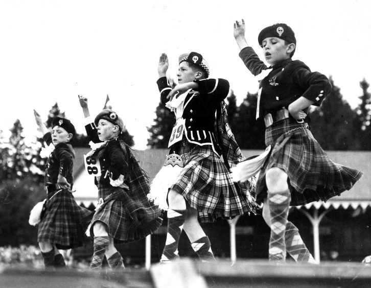 Highland dancers compete for honours at the Braemar Gathering in 1952.