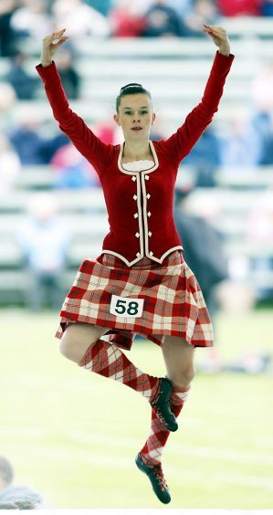 A competitor takes part in Highland Dance competition during the Braemar Gathering in Scotland in 2008