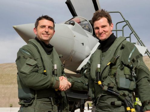 Group Captain Jim Walls, right, has taken command of RAF Lossiemouth from Group Captain Paul Godfrey, left.