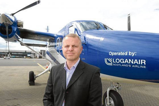 Loganair managing director Jonathan Hinkles  Picture by Nick Ponty  5/8/16 Loganair new branding  on ''Spirit of Glasgow'' aircraft at Glasgow Airport.