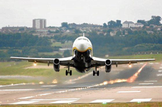 Ryanair plane landing at Aberdeen Airport.