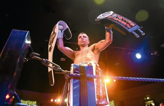 Lee McAllister with both PBC belts that he won.