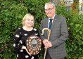 Press and Journal farming editor Gemma Mackenzie presents Pat Machray with his award