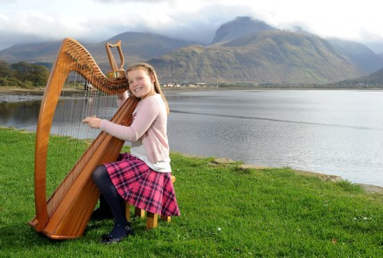 Holly Dodman of Banavie, winner of the Lawrence MacDuff Trophy for Clarsach. Picture and video by Sandy McCook