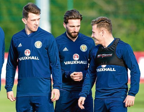(L-R) Scotland's Ryan Jack, Graeme Shinnie, and Ryan Fraser.