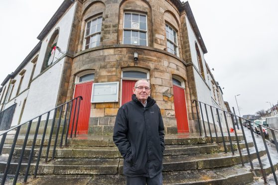 Councillor Ron Shepherd of Cullen Community Council outside the Cullen Hall which adjoins the Seafield Hotel premises.
