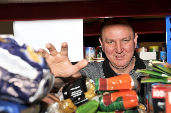 Gilbert Grieve filling food parcels at Moray Foodbank.