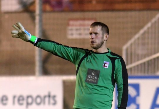 Locos' goalie Andy Reid
