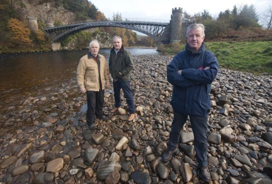 Nobody knows who owns the bridge over the River Spey at Craigellachie. Pictured: Campbell Croy chairman of Friends of Craigellachie Bridge, Richard Lochhead MSP and Jock Anderson committee member Friends of Craigellachie Bridge.