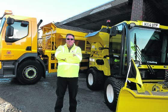 Gordon Walter with the gritter.  Picture by Jim Irvine