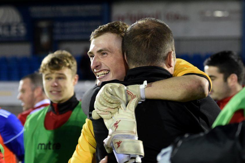 Keeper Ewan MacDonald celebrates.