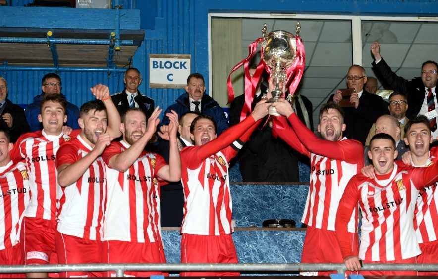Formartine celebrate with the cup.
