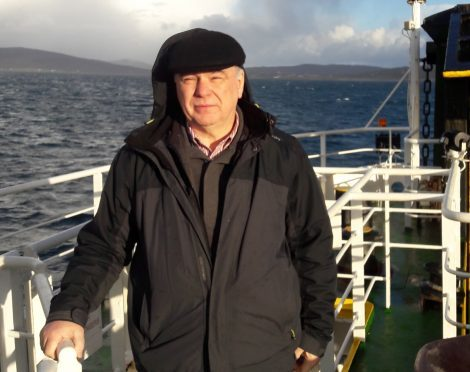 Councillor Donald Manford on the ferry from Barra to Eriskay.