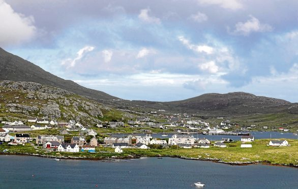File photo dated 05/06/17 of a general view of Castlebay in Barra, as two divers have died after getting into difficulty in waters off the coast of the island in the Outer Hebrides. PRESS ASSOCIATION Photo. Issue date: Sunday July 30, 2017. A ferry skipper raised the alarm with Stornoway Coastguard when he noticed a small unmanned boat off Castlebay, Barra, at around 11.20am on Saturday. The coastguard helicopter and rescue teams were sent to the scene and the divers were found by Barra lifeboat crew at around 1pm. They both died at the scene. See PA story POLICE Divers. Photo credit should read: Andrew Milligan/PA Wire