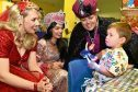 The cast (from left) Nicola Jane Meehan (Scheherazade), Lisa-Anne Wood (Princess Jasmine), Jimmy Osmond (Abanazar) with two year old Harry Westwood from Banchory. Pictures by Colin Rennie.