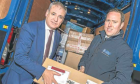 Richard Lochhead, left, with Fraser maclean who manages a busy menzies distribution depot