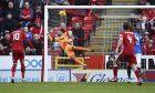 Aberdeen's Frank Ross scores to make it 2-1.