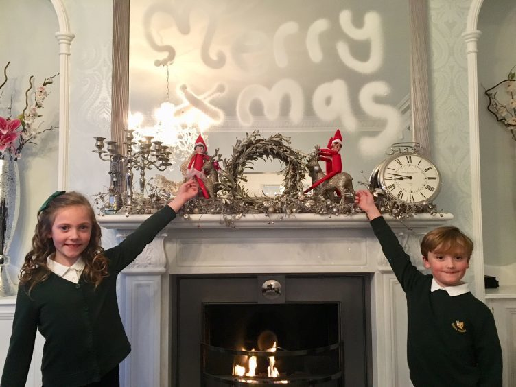 Caitlin and Myles Cooper with their festive elves