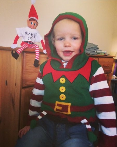 Aiden with his little elf pal. Sent in by Amy Roberts.