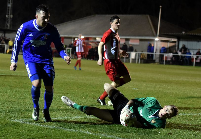 Connor Scully is beaten by the keeper, Ewen MacDonald.