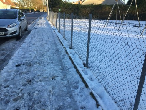 An icy covered pavement on Westhill Road, outside SensationALL's premises is just one of the treacherous north-east streets.