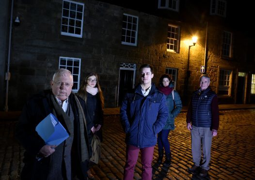 Professor Claude Wischik (left) is pictured with Gordon Mutch, chair of Old Aberdeen Community Council (right) and students (from left) Maja Skretowska, Jacub Cudak and Maria Manicone. Photograph by Colin Rennie