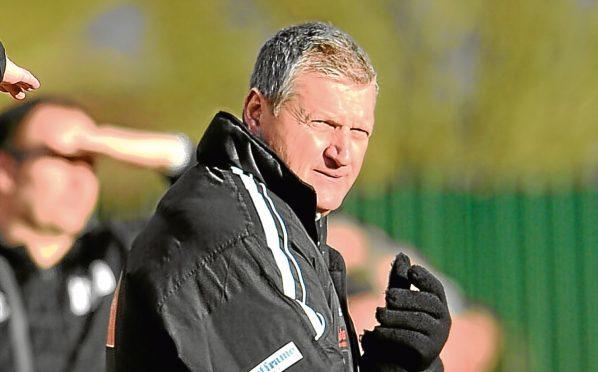 Locos manager Neil Cooper.
