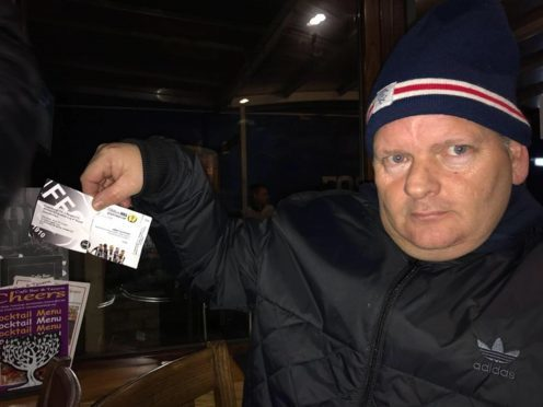 Gers fans Brian Robertson showing an allegedly fake ticket.