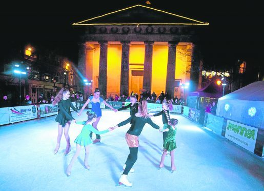 Kids from Caledonia ice skating club perform at Elgin Ice Festival on the outdoor ice ring to mark the end of the festival.