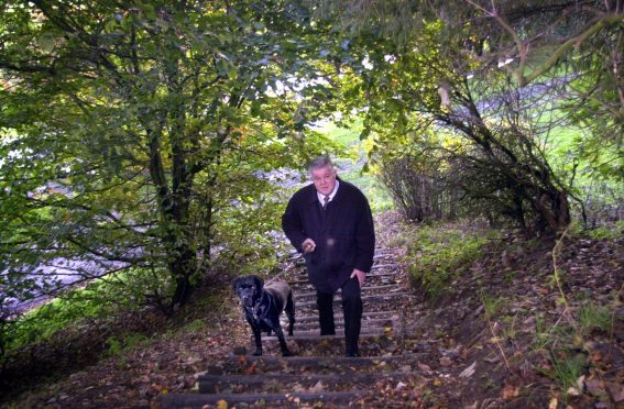 Former Grampian Country Food Group boss Mike Stephen with his dog, Angus   Picture: Jim Irvine
