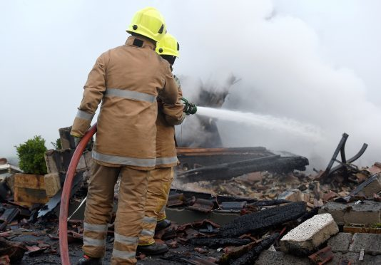 Picture by SANDY McCOOK   3rd January '17 Firefighters continue to extinguish the fire which destroyed a house in the Foxhole area of Kiltarlity overnight Tuesday to Wednesday.