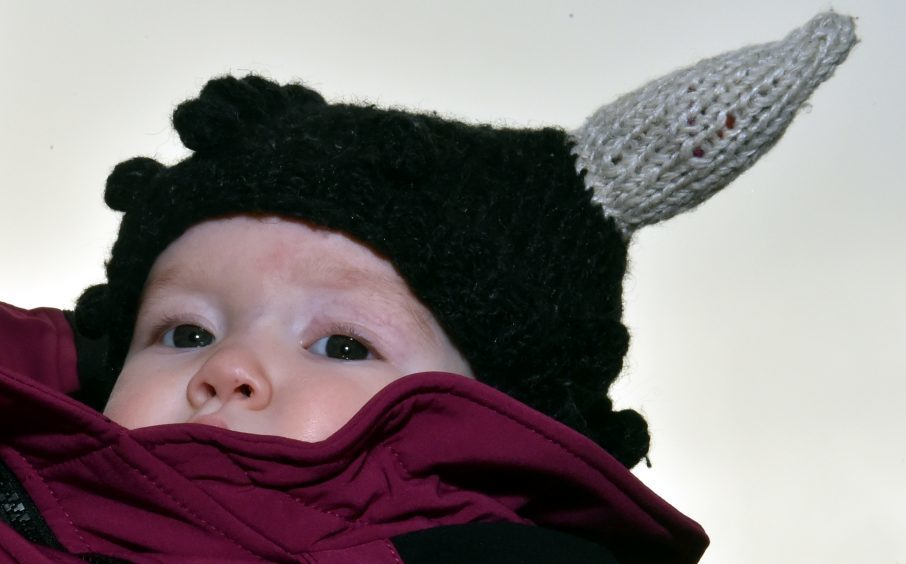 10 month old Runa Hagon looking forward to the procession. Picture by Colin Rennie