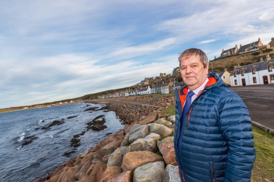 Councilor Gordon Cowie at the coast of Portessie