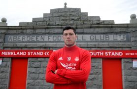 McKenna signs new deal with Dons