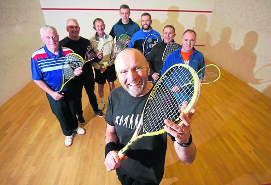 In photo at the front is John Ramsbottom with other members of the club.