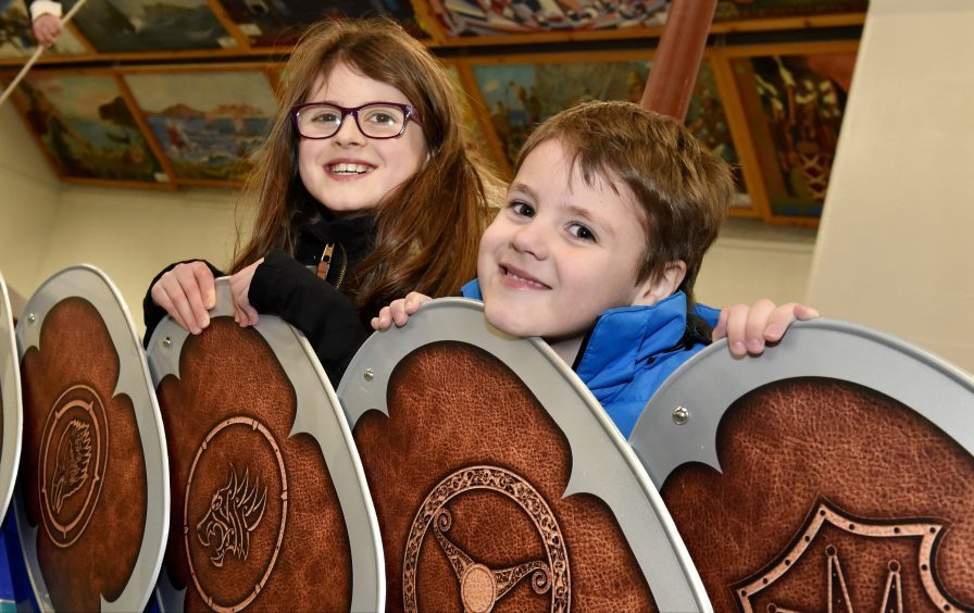 Isla Scolley, 9, with brother Jordan 5, admire the detail of the shields on the side of the Galley. Picture by Colin Rennie