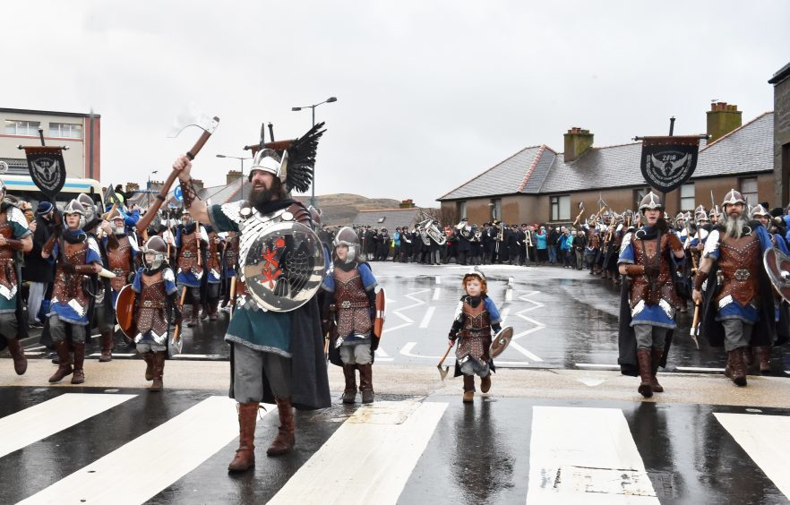 Shetland - Up Helly Aa - 2018 - Tuesday morning - The parade. Guizer Jarl Stewart Jamieson with one of the younger squad Odin Geddes, 4. Picture by COLIN RENNIE  January 30, 2018.