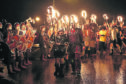 Members of the Junior Jarl Squad carry flaming torches through Lerwick
