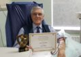 Les Boulton with his award and certificate