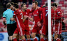 Aberdeen's Adam Rooney celebrates his goal with team mates yesterday.