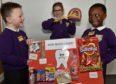 Heathryburn School launched Sugar Smart healthy living campaign. Pupils Cole Meldrum, 6 (left) and Honour Akinkunle, 5 with Laura Stefanska-Bacinski, 7