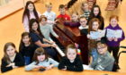 Preview for the VSA Sing Sing Sing, choral competition at the Beach Ballroom, Aberdeen, on 20th May.     Pictured - Laura Pike at the piano with the Sing Sing Sing childrens choir for rehearsals.      Picture by Kami Thomson.